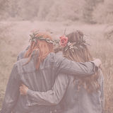 Image of two women hugging as they walk