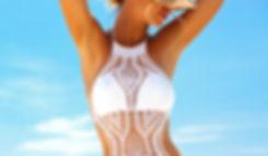 Beautiful woman wearing crochet bikini p