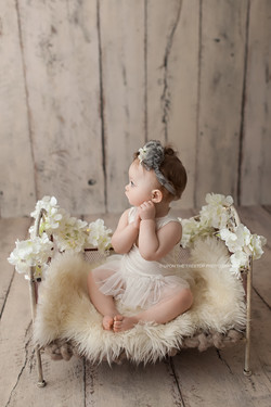 baby girl on small bed
