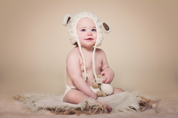 baby with lamb hat
