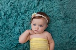 baby girl on aqua float