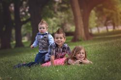 three siblings posing