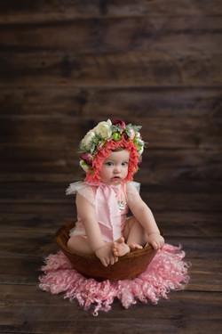 baby girl in floral bonnet