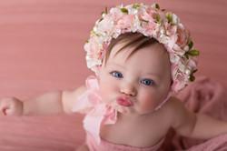 baby in peach floral bonnet