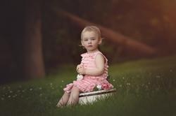 girl sitting on bucket