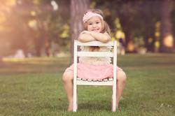girls sitting on white chair