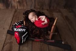 newborn with hockey glove
