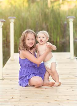 siblings on a dock
