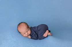 newborn boy in blue