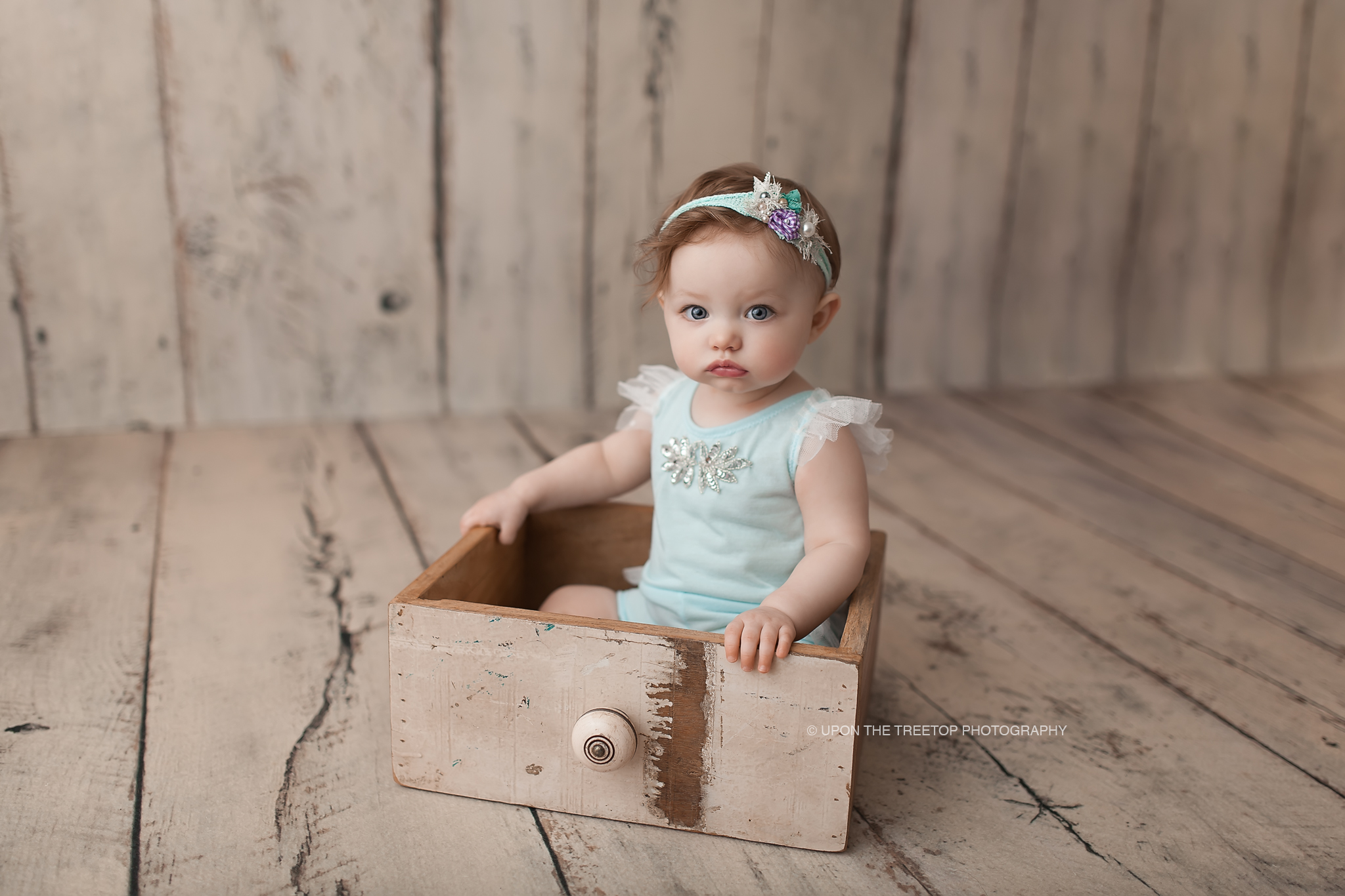 baby in wood drawer