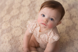 baby on cream lace