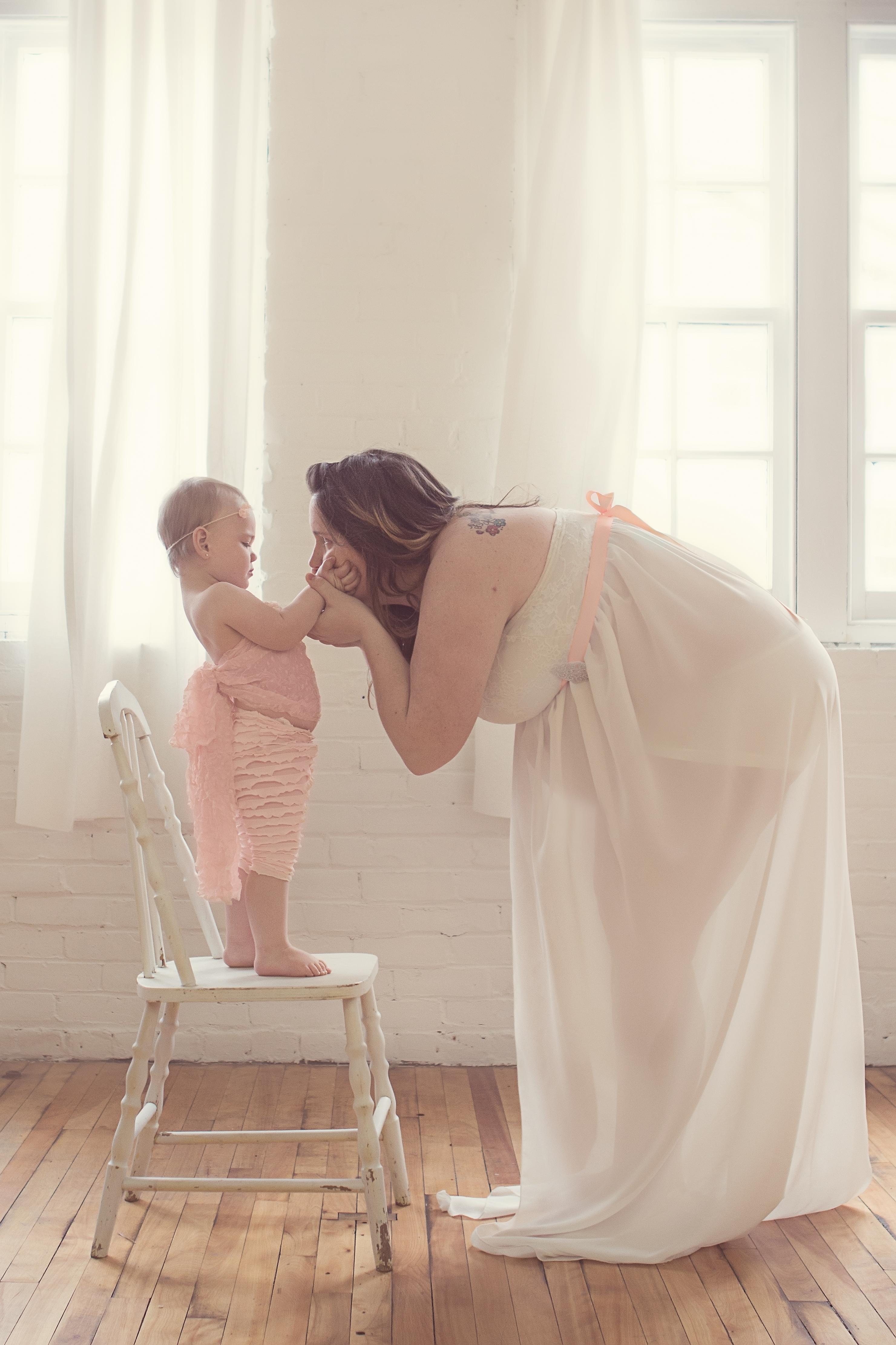 toddler touching moms face