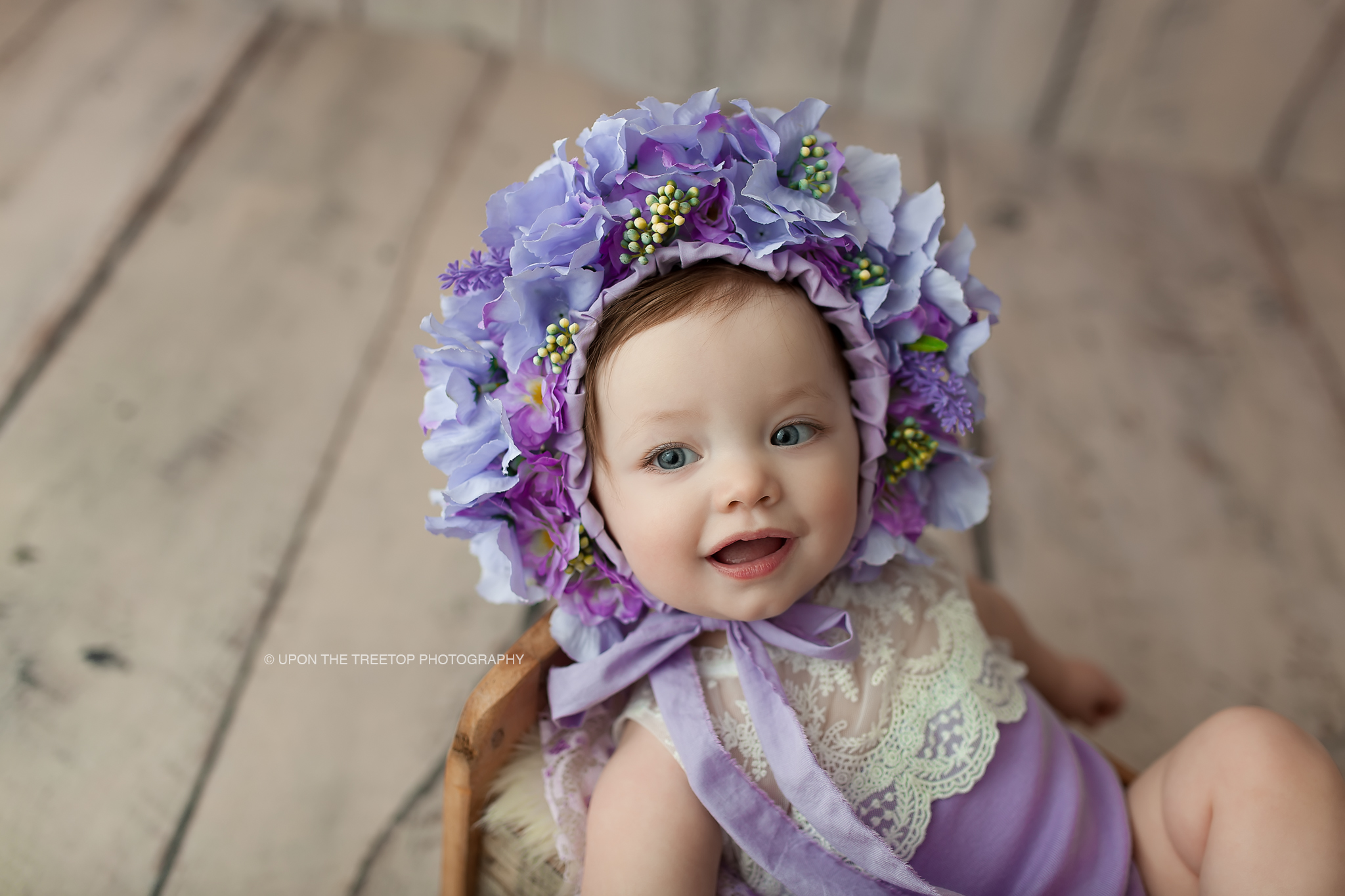 baby girl in purple bonnet