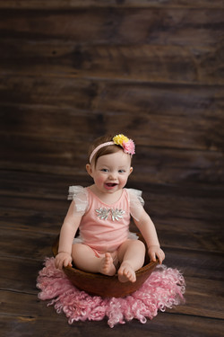 baby girl in peach