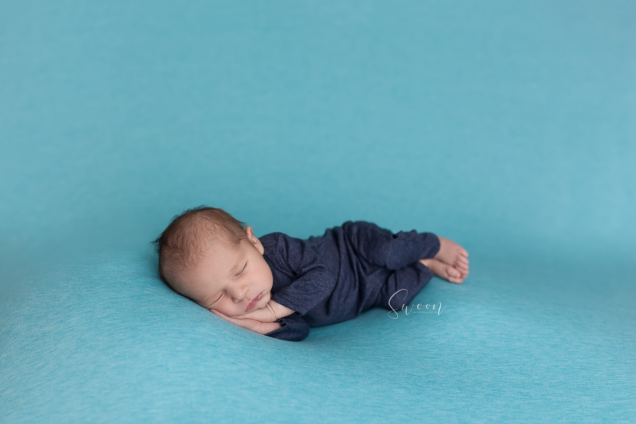 newborn in blue