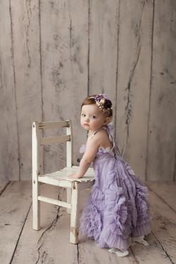 baby girl in purple dress
