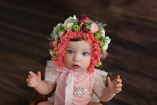 Baby girl in floral bonnet