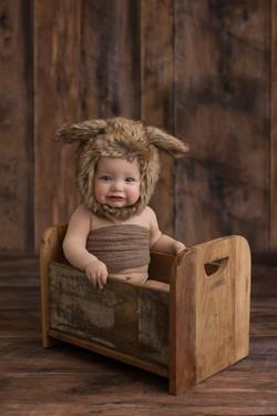 Baby girl in fur bonnet