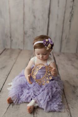 baby girl holding crown