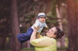 mom holding up baby boy