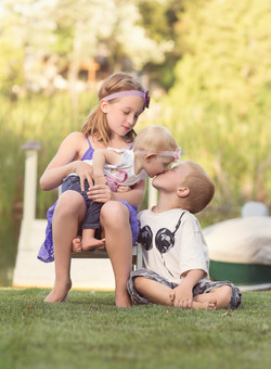 baby kissing brother