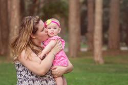 woman kissing baby on cheek