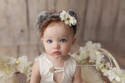 baby girl in koala ears