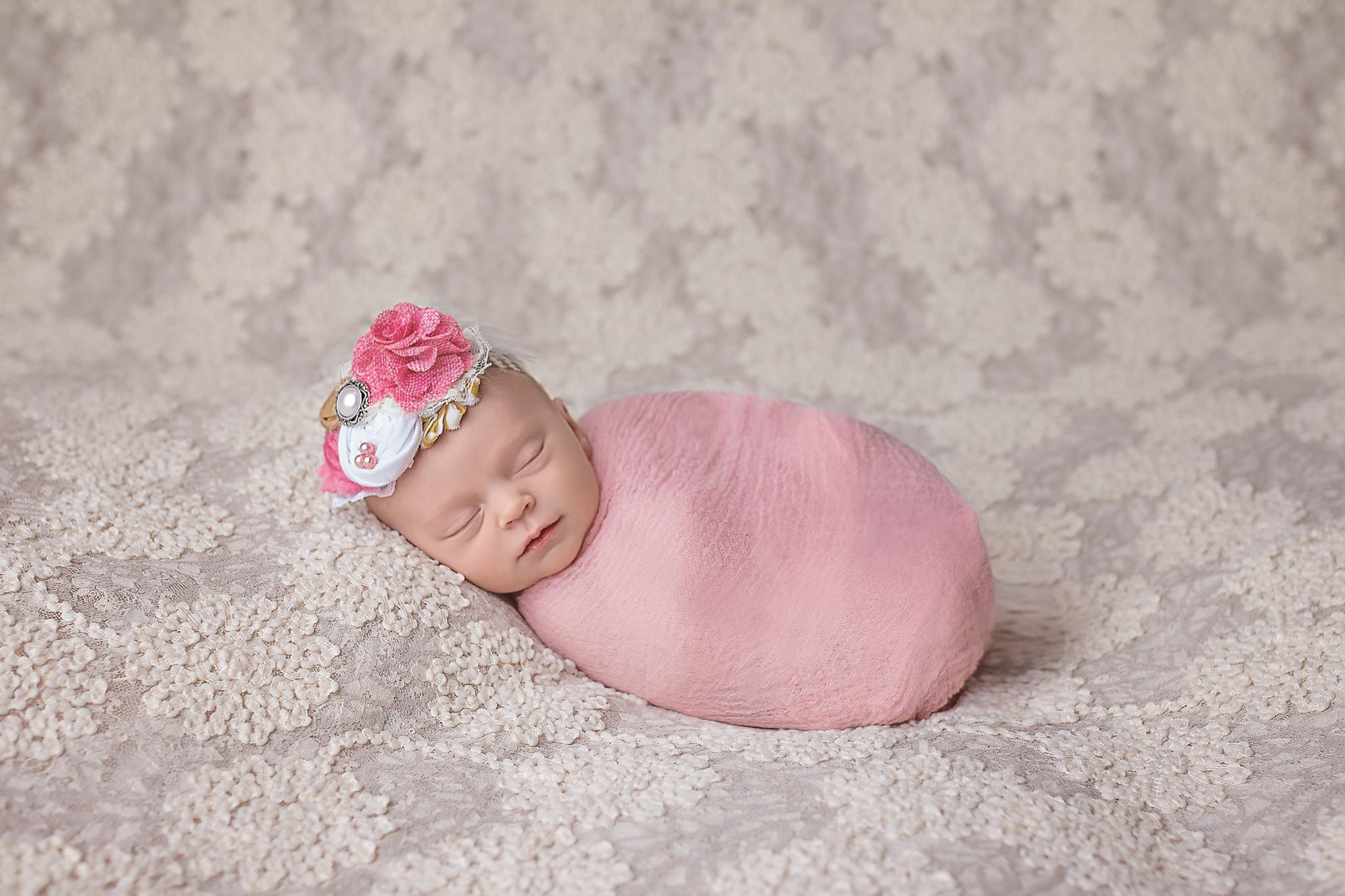 newborn girl on lace