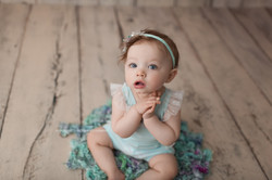 baby girl on aqua curls