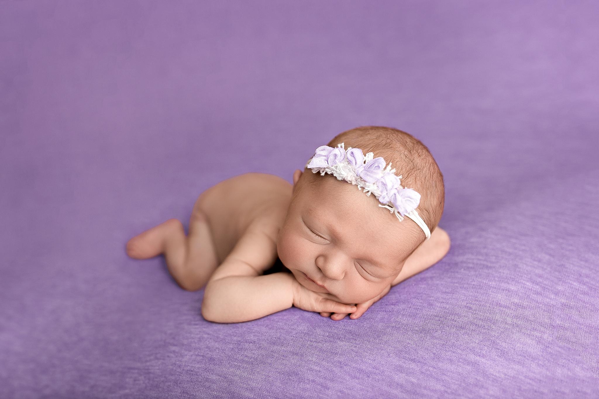 baby girl on purple