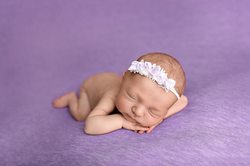 baby girl on purple