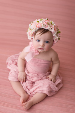 baby girl in peach floral