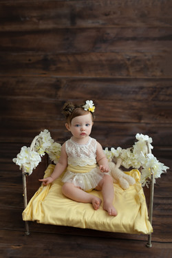 baby girl in yellow