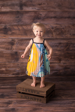 child standing on crate
