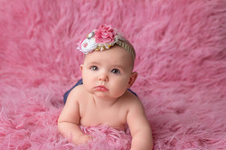 baby on pink float