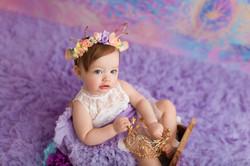 baby girl on purple float