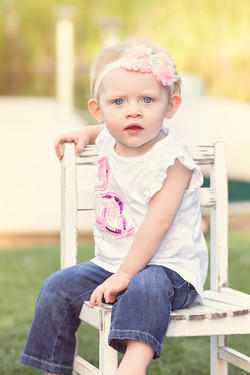 toddler on white chair