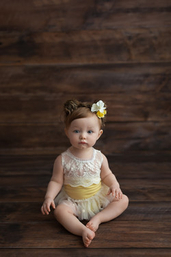 baby girl in yellow lace
