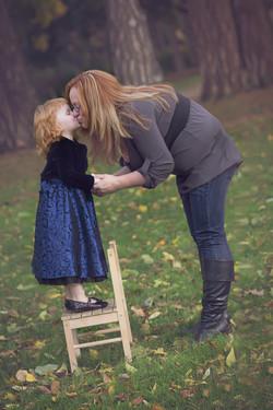 toddler kissing mother