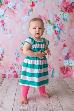 baby in stripe shirt