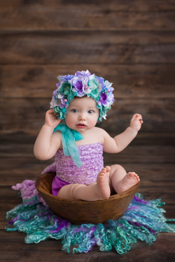 baby in wood bowl