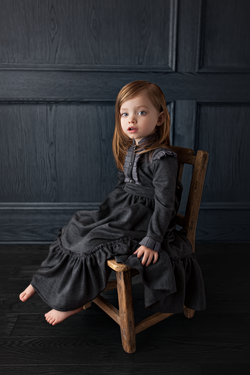 girl sitting in wood chair