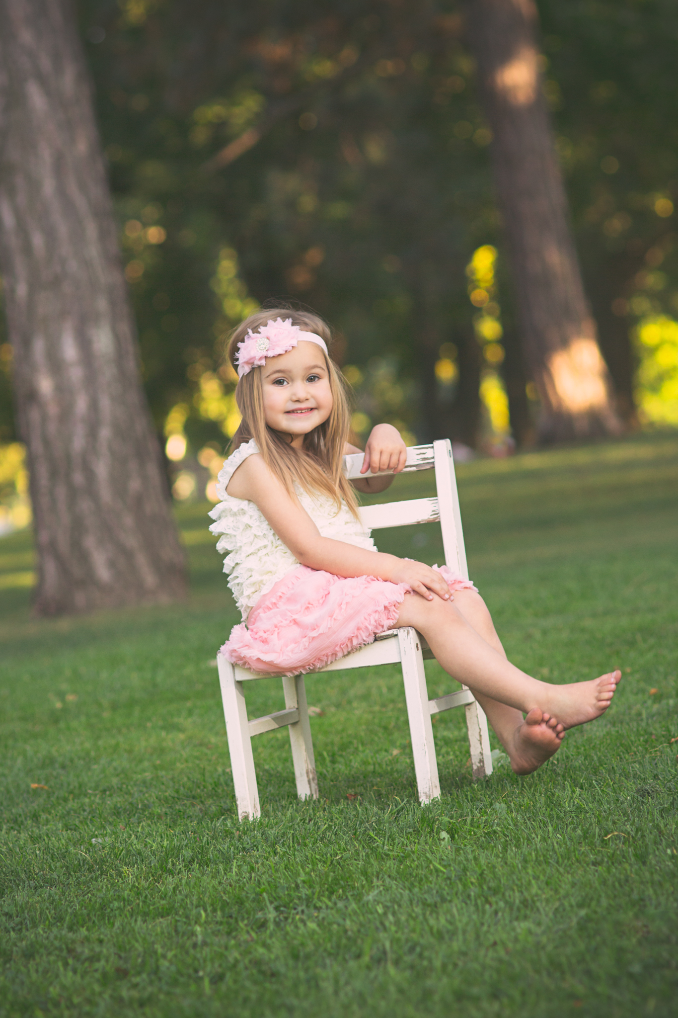 girl sitting on white chair