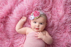 baby girl in pink and gold