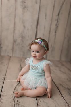 baby girl in mint