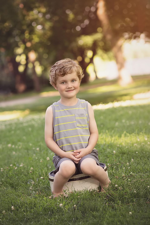 boy sitting on bucket
