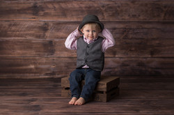 child on wood crate