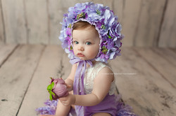 baby girl and purple flowers