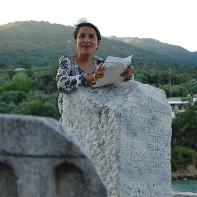 Giving a reading on Thasos with ancient column as podium.