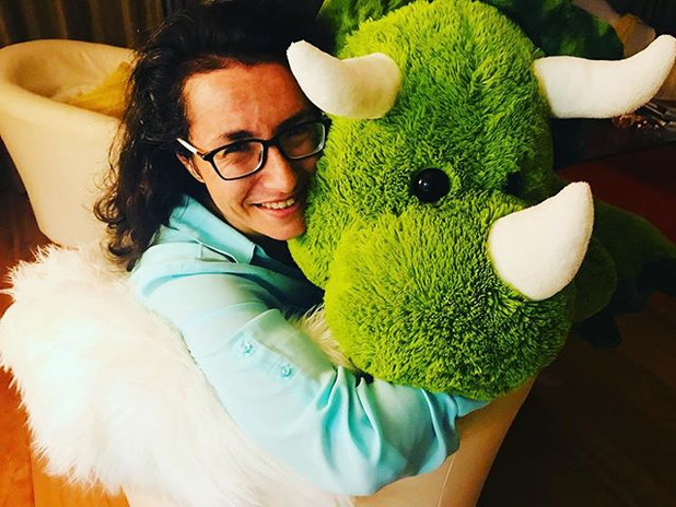 Getting a little love from Gerald the stuffed dinosaur. Also, author photo for my eventual YA book.